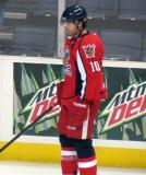 Jeff Hoggan stands near the boards during pre-game warmups before a Grand Rapids Griffins game.