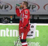 Landon Ferraro takes a drink of Gatorade at the bench during pre-game warmups before a Grand Rapids Griffins game.