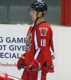 Cory Emmerton stands at the boards during pre-game warmups before a Grand Rapids Griffins game.