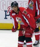 Ryan Sproul crouches near the blue line during pre-game warmups before a Grand Rapids Griffins game.