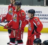 Ryan Sproul and Gustav Nyquist stand in a group of players during pre-game warmups before a Grand Rapids Griffins game.