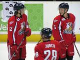 Calle Jarnkrok and Teemu Pulkkinen stand in the neutral zone, talking, during pre-game warmups before a Grand Rapids Griffins game.
