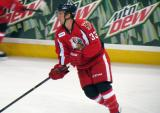 Luke Glendening skates away from the boards during pre-game warmups before a Grand Rapids Griffins game.