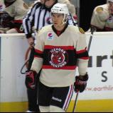 Adam Clendening of the Rockford IceHogs skates off the bench prior to the start of a game against the Grand Rapids Griffins.