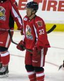 Luke Glendening stands before a faceoff during a Grand Rapids Griffins game.