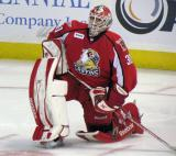 Tom McCollum stretches near the bench during a stop in play in a Grand Rapids Griffins game.