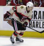Drew LeBlanc of the Rockford IceHogs skates along the boards during a game against the Grand Rapids Griffins.