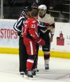 Triston Grant of the Grand Rapids Griffins and Theo Peckham of the Rockford IceHogs have to be separated by officials after a scrum in the Rockford end.
