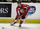 Teemu Pulkkinen skates along the boards with the puck during a Grand Rapids Griffins game.