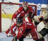 Tom McCollum tries to see through traffic - including teammate Andrej Nestrasil- during a Grand Rapids Griffins game.