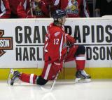 Calle Jarnkrok stretches in front of the bench before the start of the third period of a Grand Rapids Griffins game.