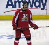 Riley Sheahan gets set for the opening faceoff of the third period of a Grand Rapids Griffins game.