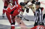 Luke Glendening of the Grand Rapids Griffins lines up for a faceoff against Phillip Danault of the Rockford IceHogs.