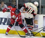 Brennan Evans of the Grand Rapids Griffins fights for the puck with Mark McNeill of the Rockford IceHogs.