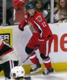 Calle Jarnkrok skates up the boards, looking over his shoulder, during a Grand Rapids Griffins game.