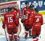 Mitch Callahan, Tom McCollum, Xavier Ouellet, Cory Emmerton and Nathan Paetsch meet in the crease to celebrate a Grand Rapids Griffins win.