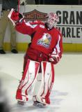 Tom McCollum raises his stick to the crowd after being selected as the third star of a Grand Rapids Griffins game.