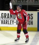 Ryan Sproul prepares to toss a t-shirt into the stands after being selected as the second star of a Grand Rapids Griffins game.