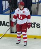 Nathan Paetsch stands along the boards during pre-game warmups before the Grand Rapids Griffins play at Comerica Park.