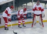Alexey Marchenko, Triston Grant and Jared Coreau stand along the boards during pre-game warmups before the Grand Rapids Griffins play at Comerica Park.
