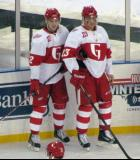 Calle Jarnkrok and Triston Grant stand along the boards during pre-game warmups before the Grand Rapids Griffins play at Comerica Park.