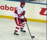 Alexey Marchenko skates with a puck during pre-game warmups before the Grand Rapids Griffins play at Comerica Park.