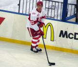 Luke Glendening skates with a puck during pre-game warmups before the Grand Rapids Griffins play at Comerica Park.