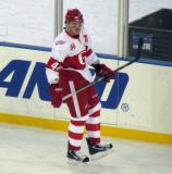 Brennan Evans skates along the boards during pre-game warmups before the Grand Rapids Griffins play at Comerica Park.