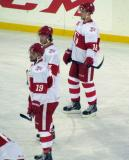 Riley Sheahan, Nick Jensen and Cory Emmerton stand at the top of a faceoff circle during pre-game warmups before the Grand Rapids Griffins play at Comerica Park.