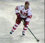 Nathan Paetsch carries the puck during a Grand Rapids Griffins game at Comerica Park.