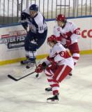 Alexey Marchenko and Calle Jarnkrok go into the corner with David Broll of the Toronto Marlies during a Grand Rapids Griffins game at Comerica Park.