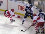 Teemu Pulkkinen slashes Stuart Percy of the Toronto Marlies, while Alexey Marchenko and Toronto's Brad Ross cover the boards during a Grand Rapids Griffins game at Comerica Park.