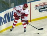 Cory Emmerton carries the puck in the corner during a Grand Rapids Griffins game at Comerica Park.