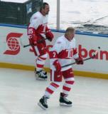 Petr Klima and Garry Unger skate along the boards during pre-game warmups before the first game of the Alumni Showdown.