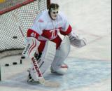 Eddie Mio, wearing an old-school mask, gets set in the crease during pre-game warmups before the first game of the Alumni Showdown.