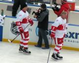 Brent Fedyk and Garry Unger skate along the boards during pre-game warmups before the first game of the Alumni Showdown.