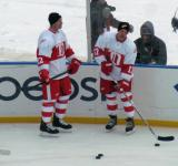 Mike Knuble and Dallas Drake stand along the boards during pre-game warmups before the first game of the Alumni Showdown.