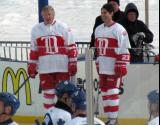Garry Unger and Mathieu Schneider stand at the boards prior to the start of the first game of the Alumni Showdown.