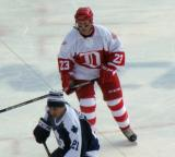 Kevin Miller shadows Mark Osborne during the second period of the first game of the Alumni Showdown.