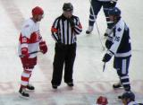 Jimmy Carson and Mike Krushelnyski get set for a faceoff during the second period of the first game of the Alumni Showdown.