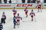 The Red Wings alumni team jumps onto the ice after beating the Maple Leafs alumni in the first game of the Alumni Showdown.