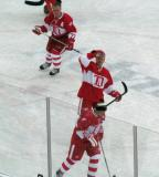 Paul Coffey, Mark Howe and Steve Yzerman skate during pre-game warmups before the second game of the Alumni Showdown.