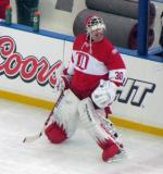 Chris Osgood stands along the boards during pre-game warmups before the second game of the Alumni Showdown.