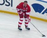 Nicklas Lidstrom carries a puck along the boards during pre-game warmups before the second game of the Alumni Showdown.
