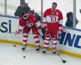 Steve Yzerman and Nicklas Lidstrom stand along the boards during pre-game warmups before the second game of the Alumni Showdown.