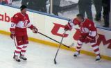 Doug Brown and Igor Larionov stand along the boards during pre-game warmups before the second game of the Alumni Showdown.