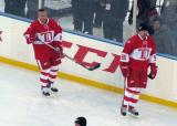 Igor Larionov and Tomas Holmstrom skate along the boards during pre-game warmups before the second game of the Alumni Showdown.