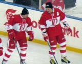 Vyacheslav Kozlov and Sergei Fedorov skate near the boards during pre-game warmups before the second game of the Alumni Showdown.