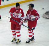 Sergei Fedorov and Chris Chelios talk during pre-game warmups before the second game of the Alumni Showdown.