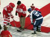 Steve Yzerman and Darryl Sittler take a ceremonial faceoff before the start of the second Alumni Showdown game, with pucks dropped by Gordie Howe and Ted Lindsay.